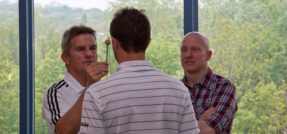 Paul assessing Alex Belt (professional golfer). Behavioural optometrist Alex Gage observes with interest.